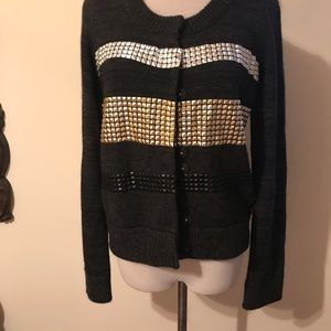 Sweater with gold and silver appliqués